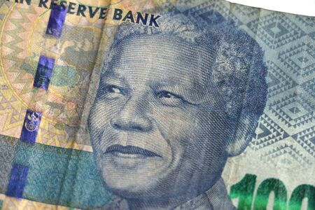 Nelson Mandelas face on the South African 100 rand bill money currency
