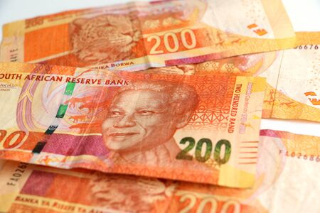 South African R200 note money currency piled up with Nelson Mandelas face