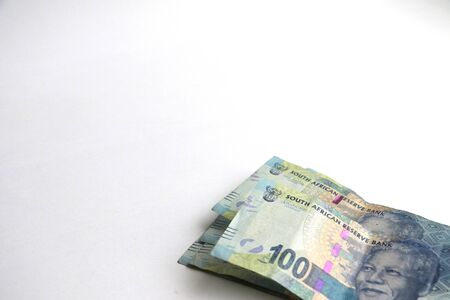 Isolated stack of South African one hundred rand notes money currency with space for text