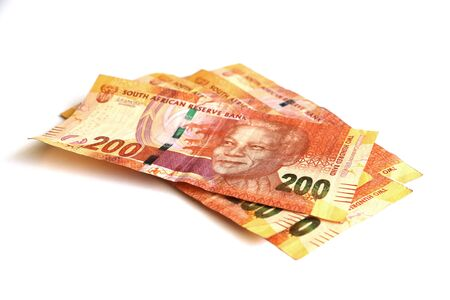 neat isolated pile of South African two hundred rand notes, money, currency