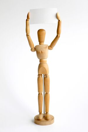 Wooden mannequin holding blank sign isolated on a white background