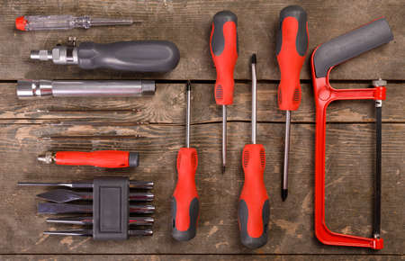 Set of tools on wooden background. Top view with copy space.