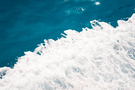 Blue water and white foam background divided in half. Diagonal, concept Foto de archivo - 109912037