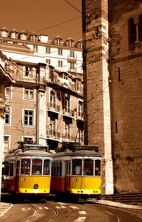 nearness: Streetcars yellow raising the hills of lisboa in the nearness of the cathedral