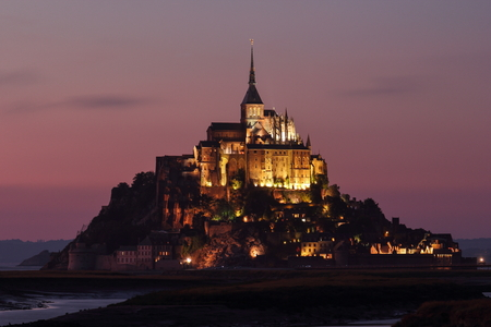 The abbey of Mont Saint Michel is perched on a rock overlooking the estuary of the river Couesnon. The abbey is adapted to the shape of the rock. Editorial