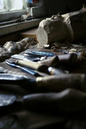 adeptness: dirty workshop of woodcarver with instruments set Stock Photo