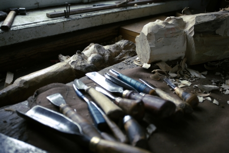 metier: dirty workshop of woodcarver with instruments set Stock Photo