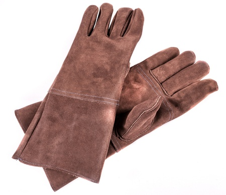 leather gloves: Close up of a brown leather welders gloves