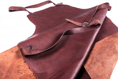 Brown leather apron protection for welder photo
