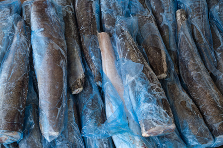 several slices of frozen fish photo