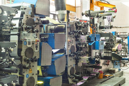 offset printing: Printing at high speed on offset machine. Label, Rolled Up, Printing Out, Group of Objects, Merchandise