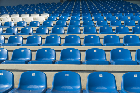 pitching: Rows of empty bleachers positioned in a semicircular pattern. Stadium seats before an event. Stock Photo