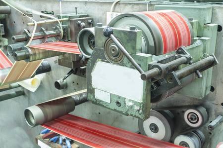 out of production: Printing at high speed on offset machine. Label, Rolled Up, Printing Out, Group of Objects, Merchandise