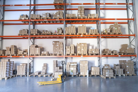 lifter: Yellow fork lifter work in big warehouse Stock Photo