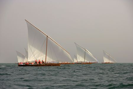Racing traditional dhows in the Arabian Gulf off Dubai. Stock Photo - 7427183
