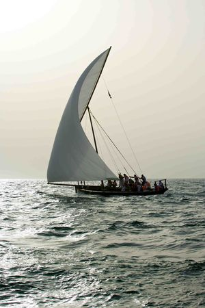A traditional dhow sailing in the Arabian Gulf, off Dubai. Stock Photo - 7396015