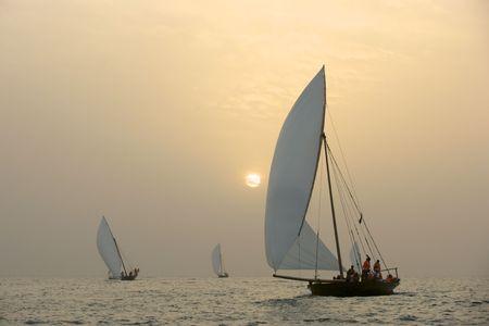 körfez: Traditional racing dhows at sunset, in the Arabian Gulf, near Dubai.