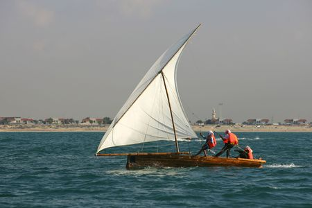 Young sailors in a traditional racing dhow in the Arabian Gulf, off Dubai.