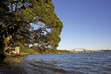 A boathouse with Auckland Harbour Bridge in the background, New Zealand Stock Photo - 7577353