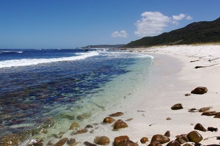 The cold, clear waters of the Atlantic Ocean at Maclear Beach, in the Cape of Good Hope area of the Cape Peninsula, South Africa. Stock Photo - 7646426