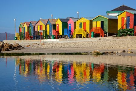badning: Brightly painted wooden bathing huts at St James Beach, near Cape Town, South Africa.