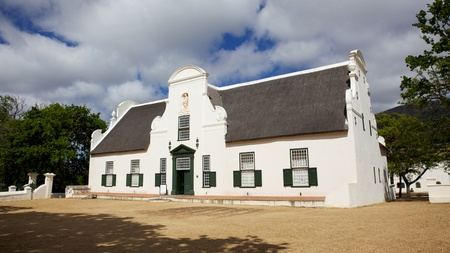 Groot Constantia, the finest surviving example of Cape Dutch architecture, and one of South Africa's foremost historical monuments tourist attractions, dates back to 1685. Groot Constantia has been producing wine for more than three centuries. In 1685, Stock Photo - 8374935