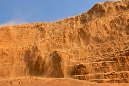 gcc: A waterfall of sand in the desert near Dubai in the United Arab Emirates. Stock Photo