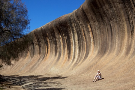 natural landmark: Mature woman at Wave Rock, near Hyden in Western Australia.