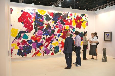 exhibitions: DUBAI - JANUARY 18: Visitors at Art Dubai, the leading and largest art fair in the Middle East. Despite political unrest, galleries are reporting strong sales and a growing interest in Middle Eastern Art and this years fair will be held from March 21-24. Editorial