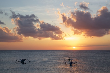 outrigger: Traditional jukungs (outrigger canoes) at sunset, Tuban Beach, Bali, Indonesia.