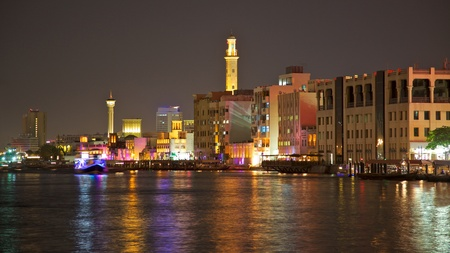 windtower: A night-time view of the Bur Dubai side of Dubai Creek, looking towards the Textile Souk.