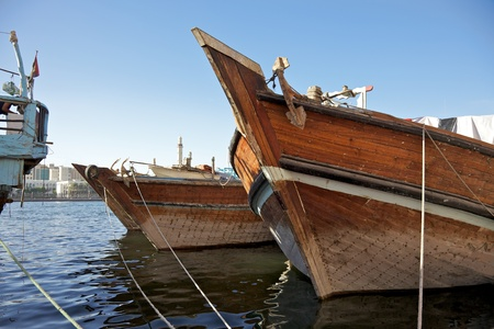 gcc: The bows of traditional wooden trading dhows moored in Dubai Creek, UAE. Stock Photo