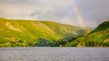 A rainbow enhances a scenic backdrop to Ullswater in England's Lake District. Stock Photo - 16691214