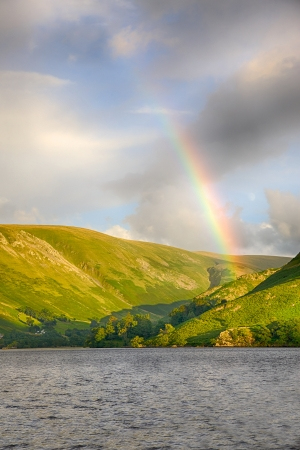A rainbow enhances a scenic backdrop to Ullswater in England's Lake District. Stock Photo - 16691232