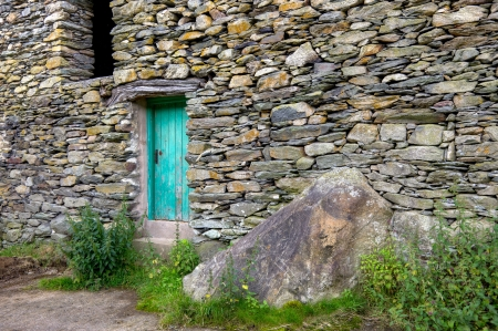 An old stone barn door off-the-beaten-track in the Ullswater area of England's Lake District. Stock Photo - 16733477