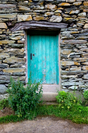 A turquoise barn door situated off-the-beaten-track in the Ullswater area of England's Lake District. Stock Photo - 16733476