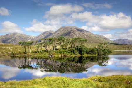 Mountainous landscape reflected in Derryclare Lough, in the Inagh Valley, County Galway, Ireland.