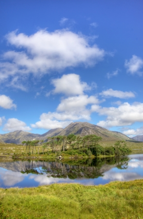 connemara: Mountainous landscape reflected in Derryclare Lough, in the Inagh Valley, County Galway, Ireland. Stock Photo