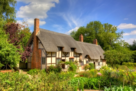 Anne Hathaways (William Shakespeares wife) famous thatched cottage and garden at Shottery, just outside Stratford upon Avon, England.  Editorial
