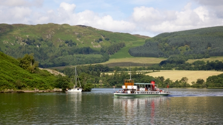 Tourists aboard the 'Raven' on Ullswater, in the English Lake District, on July 31, 2012. Although Ullswater Steamers have been sailing on the lake since 1859, the Raven was launched in 1889.