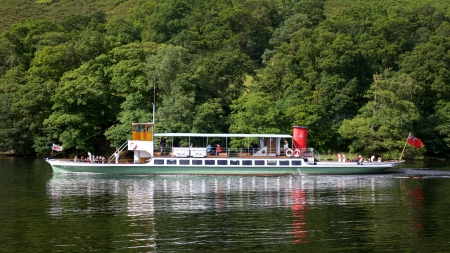 Tourists aboard the 'Raven' on Ullswater, in the English Lake District, on July 31, 2012. Although Ullswater Steamers have been sailing on the lake since 1859, the Raven was launched in 1889. Stock Photo - 17062968