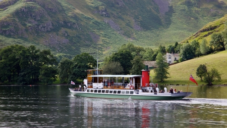 Tourists aboard the 'Raven' on Ullswater, in the English Lake District, on July 31, 2012. Although Ullswater Steamers have been sailing on the lake since 1859, the Raven was launched in 1889. Stock Photo - 17062970
