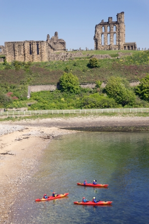 Tynemouth, UK, May 28, 2012 - Kayakers in front of Tynemouth Castle and Priory on the coast of North East England on May 28, 2012. The ancient buildings overlook the North Sea and the River Tyne. Stock Photo - 17147021