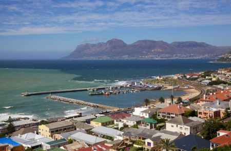 A view of Kalk Bay and its harbour from scenic Boyes Drive, near Cape Town in South Africa photo