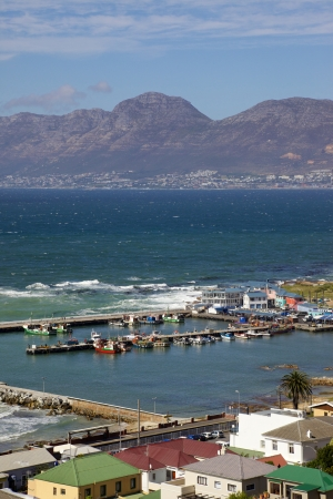 A view of Kalk Bay Harbour from scenic Boyes Drive, near Cape Town in South Africa photo