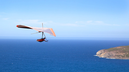 gliding: A hang glider flies off Shelley Beach in West Cape Howe National Park, near the towns of  Albany and Denmark in Western Australia  Stock Photo
