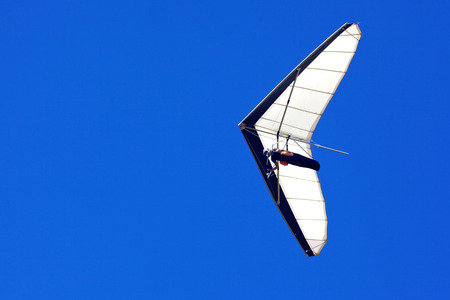 hang glider: A hang glider flies off Shelley Beach in West Cape Howe National Park, near the towns of  Albany and Denmark in Western Australia  Stock Photo