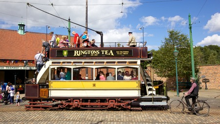 durham:  Newcastle 114 , a tram built in 1901, in the high street of the Edwardian town that forms part of Beamish Museum in County Durham, England