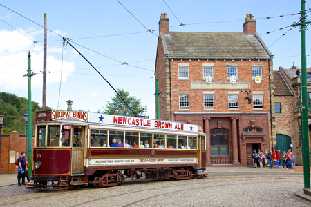 A tram in the high street of the Edwardian town that forms part of Beamish Museum in County Durham, England  Beamish is a world-famous open-air museum that tells the story of life in North-East England in Georgian, Victorian and Edwardian times