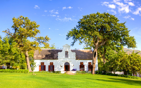 Built in 1750 in the Cape Dutch style, Laborie is considered the most important house in an architectural sense in the Paarl area of the Western Cape in South Africa  HDR image  Stock Photo